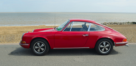 FELIXSTOWE, SUFFOLK, ENGLAND -  MAY 07, 2017: Classic Red Porsche 912 parked on seafront promenade. Editorial