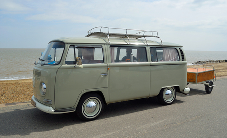 FELIXSTOWE, SUFFOLK, ENGLAND -  MAY 07, 2017: Classic Volkswagen  Camper Van with trailer Parked on Seafront Promenade