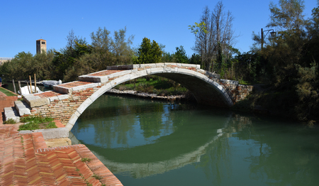 Bridge over the canal Torcello Venice  on the island of Torcello.