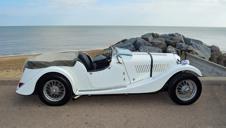 FELIXSTOWE, SUFFOLK, ENGLAND - MAY 07, 2017: Classic White Sports Motor Car Parked on seafront promenade.