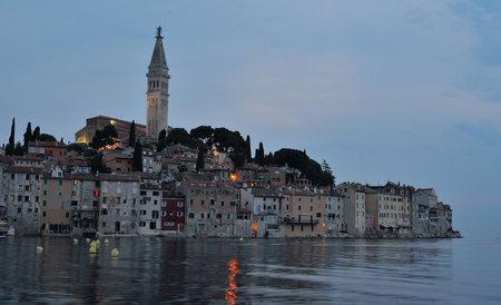 Evening view of Rovinj old town  peninsular  with the Church of St. Euphemia  on the Adriatic Coast  Line Istria Croatia. Banco de Imagens