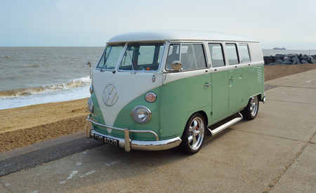 FELIXSTOWE, SUFFOLK, ENGLAND - AUGUST 27, 2016: Classic Green and white  VW Camper Van parked on Seafront Promenade. Sajtókép