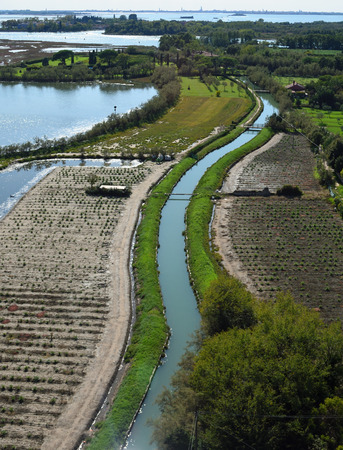 View of Small Canal in the Island of Torcello in the Venetain Lagoon. Banco de Imagens