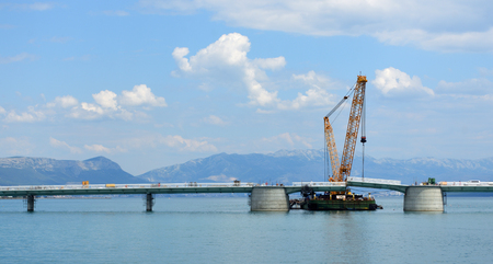 Construction of the bridge to the island of ÄŒiovo from the mainland near Trogir Split Croatia.