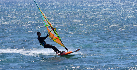 Windsurfer  travelling  at speed on the Ocean. Editorial