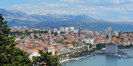 View of  Split  Seafront and old town with mountains in background.