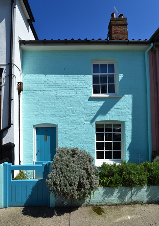 ALDEBURGH, SUFFOLK, ENGLAND - MAY 05, 2018: Terrace Cottage painted mint green in Aldeburgh.