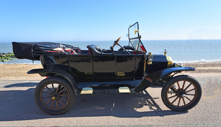 FELIXSTOWE, SUFFOLK, ENGLAND -  MAY 06, 2018: Vintage Black Model T Ford Motor Car Parked on Seafront Promenade.