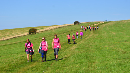 ALCISTON, EAST SUSSEX, ENGLAND - SEPTEMBER 01, 2018 : Race For Life Lady walkers on the South Downs.