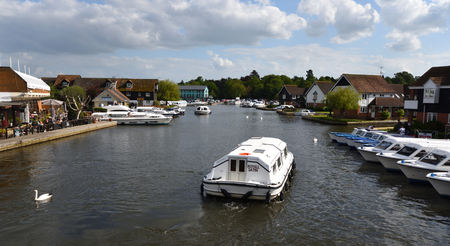 WROXHAM, NORFOLK, ENGLAND - MAY 10, 2018: View of the river Bure at Wroxham with Broads cruise. Editorial