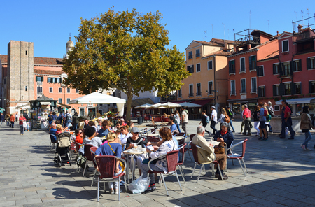 VENICE, ITALY - SEPTEMBER 26, 2017:  People enjoying Cafe in the Campo Santa Margherita Square in a quieter part of Venice. Editorial