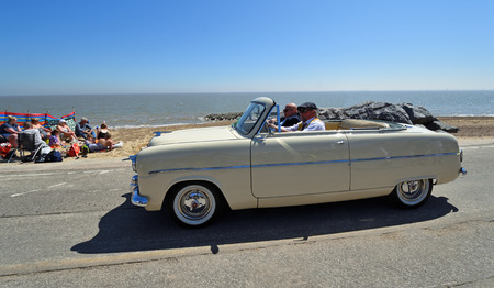FELIXSTOWE, SUFFOLK, ENGLAND -  MAY 06, 2018: Classic White Ford Zephyr Mk1 convertible Motor Car being driven along Seafront Promenade. Editorial