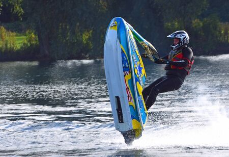 WYBOSTON, BEDFORDSHIRE, ENGLAND -  October 08, 2017: Freestyle Jet Skier performing Jump  creating at lot of spray. Éditoriale