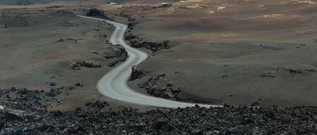 Winding Road in volcanic landscape Timanfaya park Lanzarote.