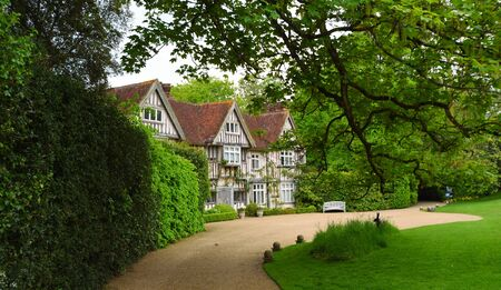 TICEHURST, EAST SUSSEX, ENGLAND - MAY 18, 2019: The Tudor Front and drive way of Pashley Manor East Sussex. Editorial