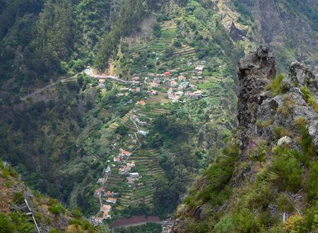 'Nuns Valley' the village of Curral das Freiras sites in deep steep sided valley Madeira Portugal.