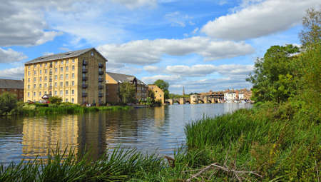 The River Ouse at St Ives  Cambridgeshire with the Old Mill,  historic bridge and river port. Standard-Bild