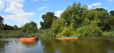 ST NEOTS, CAMBRIDGESHIRE, ENGLAND - SEPTEMBER 01, 2020: River maintenance  Aquatic Weed Cutting and Removal Editorial
