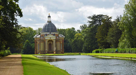 SILSOE, BEDFORDSHIRE, ENGLAND -  SEPTEMBER 04, 2020:  The Thomas Archer Pavillion and  Long Canal Wrest Park Bedfordshire. Editorial