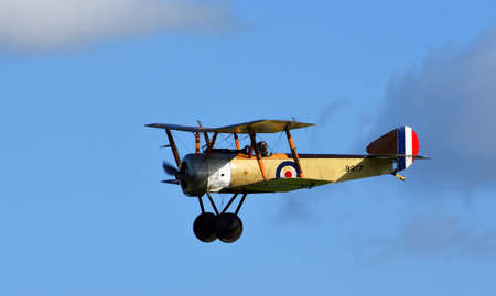 ICKWELL, BEDFORDSHIRE, ENGLAND - SEPTEMBER 06, 2020: Vintage 1916  Sopwith Pup World War 1  aircraft in flight.