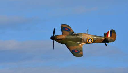 ICKWELL, BEDFORDSHIRE, ENGLAND - SEPTEMBER 06, 2020: Hawker Hurricane Mark 1 (serial P3717)  World War 2 aircraft in flight
