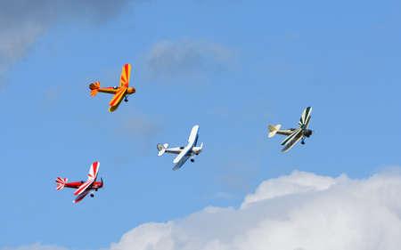 ICKWELL, BEDFORDSHIRE, ENGLAND - SEPTEMBER 06, 2020: Vintage Tiger Moth Bi Planes Flying in formation blue sky and clouds.