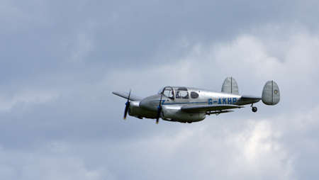 ICKWELL, BEDFORDSHIRE, ENGLAND - SEPTEMBER 06, 2020: Vintage  Miles M65 Gemini, G-AKHP  aircraft  in Flight.