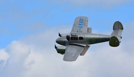 ICKWELL, BEDFORDSHIRE, ENGLAND - SEPTEMBER 06, 2020:Vintage  Miles M65 Gemini, G-AKHP  aircraft  in Flight.