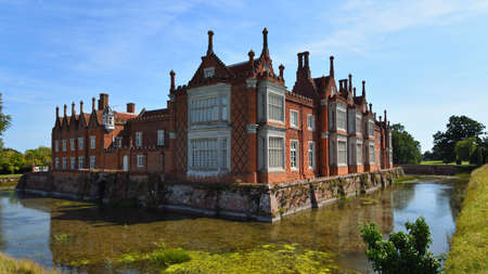 HELMINGHAM, SUFFOLK, ENGLAND - AUGUST 22, 2019:  Helmingham Hall with moat  and reflections. Editorial