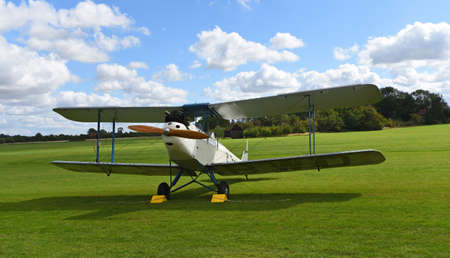 ICKWELL, BEDFORDSHIRE, ENGLAND - SEPTEMBER 06, 2020: Vintage De Havilland  1928  DH60X  Moth biplane  on airstrip