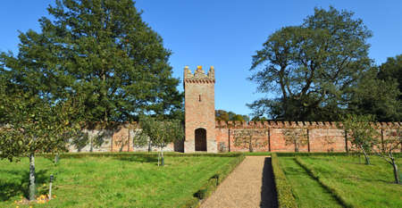 OXBOROUGH, NORFOLK, ENGLAND - SEPTEMBER 19, 2020: Wall Tower and fan trained fruit trees Oxburgh Hall Norfolk.