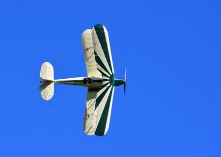 Vintage Stampe SV4C Biplane G-BPLM  in flight against Blue Sky.