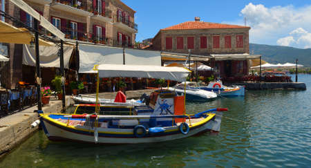 MOLYVOS, LESVOS, GREECE -  JUNE 20, 2014: Molyvos Harbour with boats and restaurants. Editorial