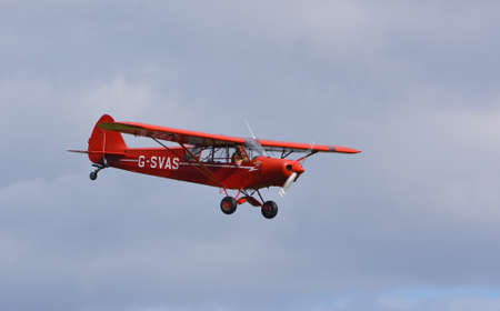 ICKWELL, BEDFORDSHIRE, ENGLAND - SEPTEMBER 06, 2020: Vintage G-SVAS PA-18 1961 Piper Super Cub  aircraft in flight.