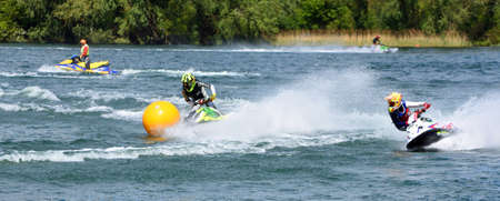 WYBOSTON, BEDFORDSHIRE, ENGLAND -  MAY  12, 2019: Two Jet Ski  race competitors creating at lot of spray.