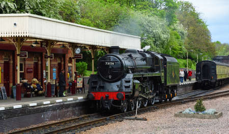 LEICESTER, LEICESTERSHIRE, ENGLAND - APRIL 27, 2019:  BR Standard Class 5 73156 Steam Engine pulling into North Leicester Heritage Railway Station.