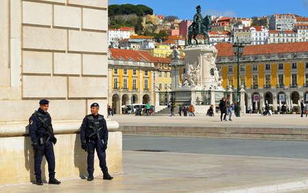 LISBON, PORTUGAL - MARCH 07, 2016: Police presence at Praca do Comercio Lisbon Portugal  2 policemen with firearms. Editorial