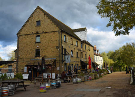 ST NEOTS, CAMBRIDGESHIRE, EMGLAND - OCTOBER 11, 2020: The River Mill Public House  former Watermill  with socially distanced customers.