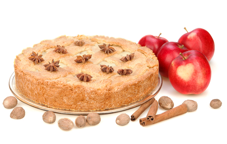 Apple pie with red apples, cinnamon, anise, nutmeg. Isolated on white background. Red apple with heart.