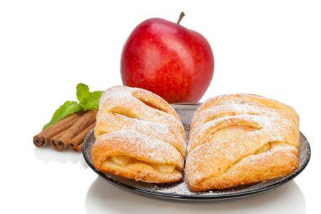 Apple and Cinnamon and mint sugar buns on dish.