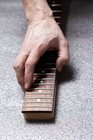 hand of a master on the fretboard of a guitar. Stok Fotoğraf