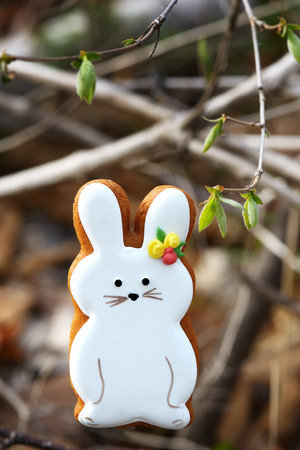 Gingerbread rabbit  in a forest on a stump Stock Photo