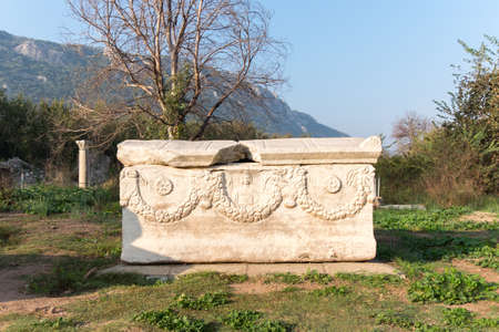 Sarcophaguses in Ephesus ancient city. There are snake, sheep and cow figures on one of them