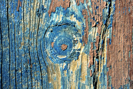 Detail from knothole on old painted door. Stock Photo