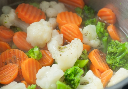Carrot, broccoli are steamed in a pan  Stock Photo - 17069965
