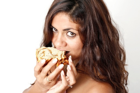 A darkhaired women eat a cake Stock Photo - 17081761