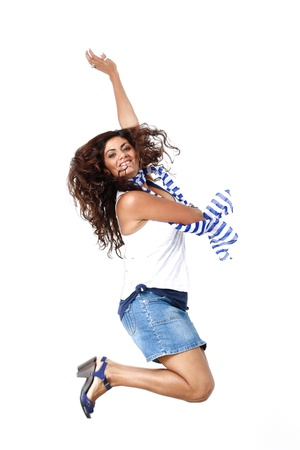 A happy girl jump in front of White background Stock Photo - 17081760