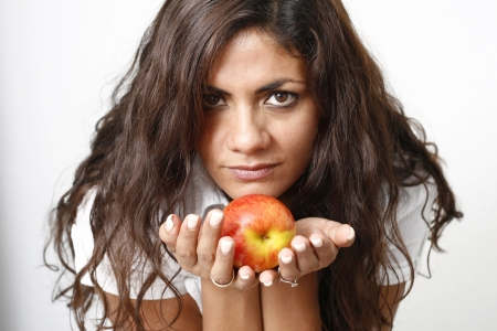 A darkhaired women show an apple in her hands Stock Photo - 17081762