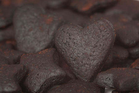 unskilled: A mount of burned cookies with a burned heart cookie
