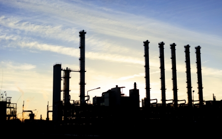 industrie: Six towers of a industrie building in front of evening sky